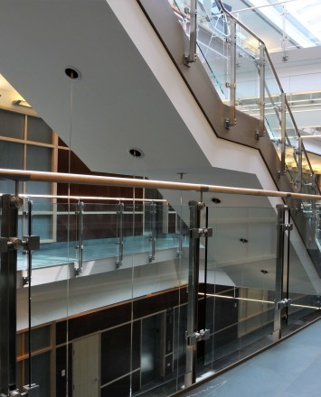 Inox wooden rail with glass infill installation in Du Page Medical Center, OH