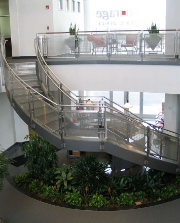 Inox curved stair rail with stainless steel infill installation at an EZ Storage, Baltimore, MD