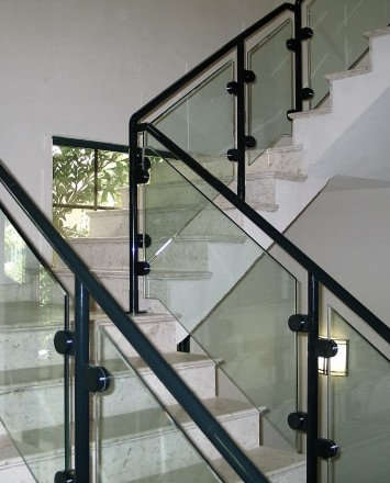 Stanford Bank, Antigua, HEWI guardrail surface mounted with clear glass infill panels