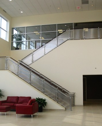 Circum leather and stainless steel handrail installation at American Leather, TX.