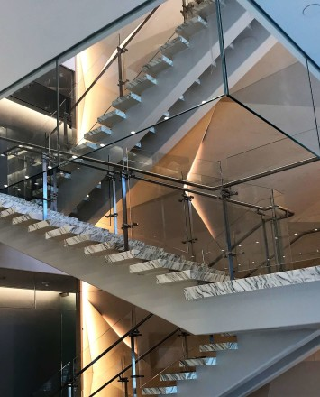 Atrium stair at Market Axess offices, Kubit glass railing system and Optik smoke baffles.