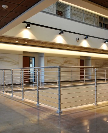 Circum round guardrail with stainless steel infill rails at Mission College, CA.