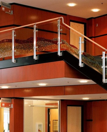 inox guardrail with cast patterned glass infill installation at the Hillsboro Civic Ctr, OR.