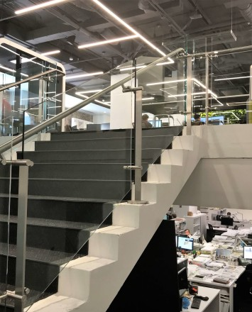 Stair at HOK Architects offices, DC, Kubit glass railing system.