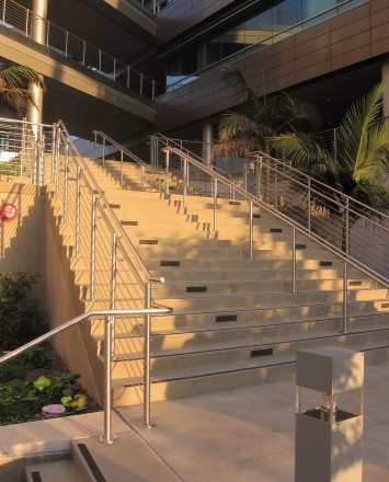 Circum wood handrail installation with horizontal infill rails at the Rady Schoolof Business, CA.