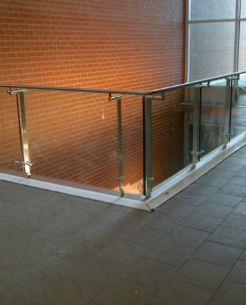 Corner view of Hanscom Air force, MA, Kubit guardrail with glass infill panels