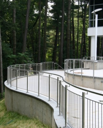 Outdoor office walkway Circum curved handrail installation at Gap International, PA.