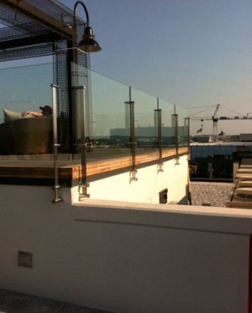 Cityscape view off of Rooftop Spa Sun Deck, DC, Kubit guardrail with glass infill panels