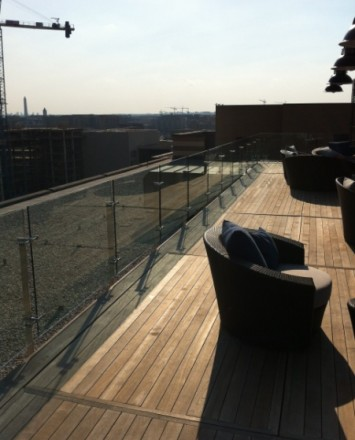 Street view off of the Rooftop Spa Sun Deck, DC, Kubit guardrail with glass infill panels