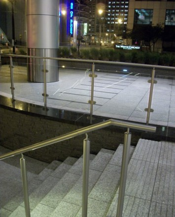 Downward angled view of N Clark Street, Chicago, IL, CIRCUM guardrail with LED railing
