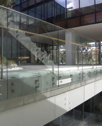 University of California San Diego, CA, Optik guardrail with clear glass and wood handrail