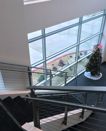 Second floor downward view of Anaheim Concourse, CA, Side mounted KOTO guardrail with custom support brackets