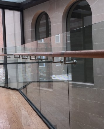 Corner view of Mount Pleasant Library, Washington DC, Optik Shoe with wood handrail and LED