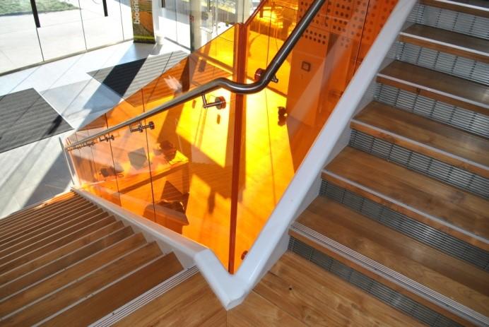 HDI Optik Shoe trendy handrail design in orange glass