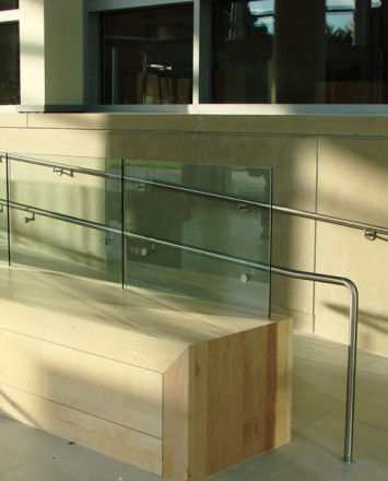 Outdoor ADA wheelchair ramp at the Slavin Center, Providence RI, Optik Shoe recessed into wall / seating area