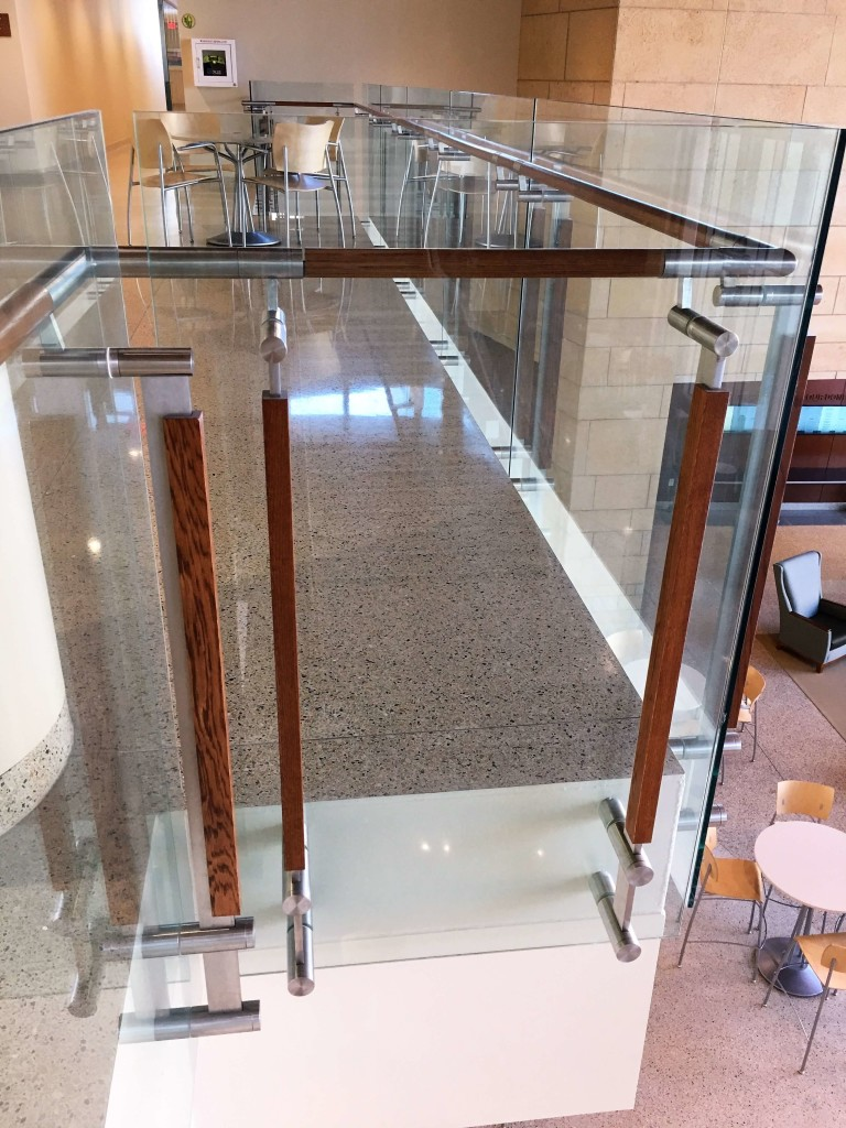 Closeup of handrail with glass infill at UW-Madison School of Nursing