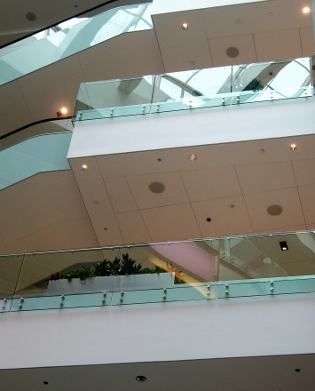 Upward view of 3 levels at a Shopping Mall Chicago, IL, Optik guardrail with clear glass