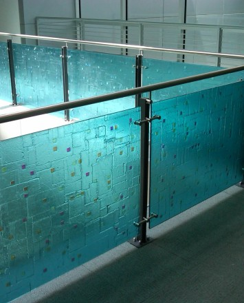 Angle view of Ferric guardrail with glass infill installation in the RCC Lobby, New York Transit, NY.