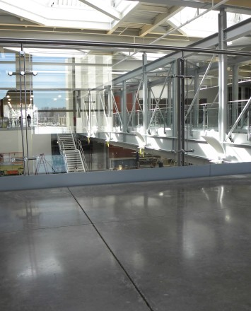 Wide angle view of Ferric guardrail installation with clear glass infill at Welch-Allyn, NY.