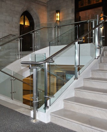 Stairwell view of Konic guardrail installation with glass infill at Mount Saint Mary's, NY.