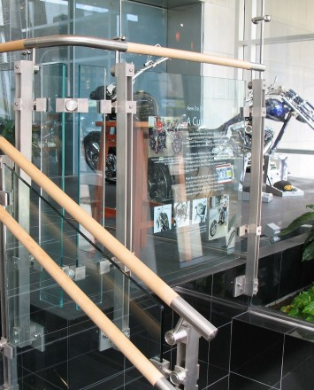 Closeup of Inox guardrail with custom glass infill panels at an office in Pennsylvania.