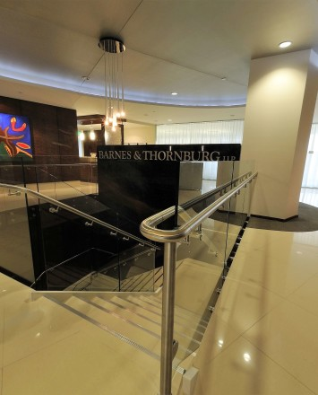Upward lobby view of Barnes and Thornberg law offices, CA, Optik guardrail with clear glass
