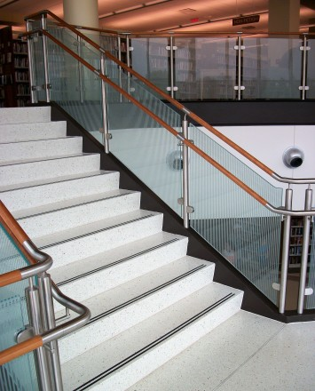 Circum handrail with glass infill installation at the Fox Lake Library, IL.