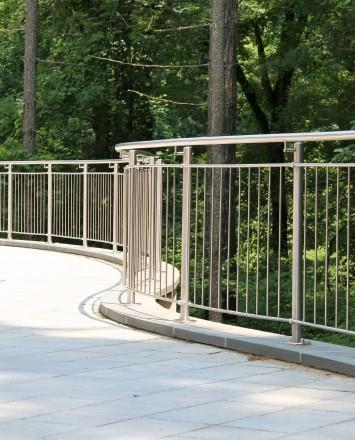 Outdoor office walkway Circum curved handrail installation at Gap International, PA.