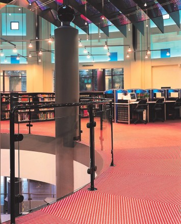 Curved Hewi guardrail with glass infill at the Kalamazoo Public Library, MI.