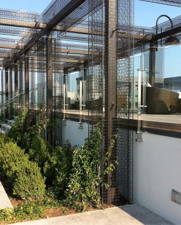 Outdoor balcony view of Rooftop Spa, DC, Kubit with glass infill panels.