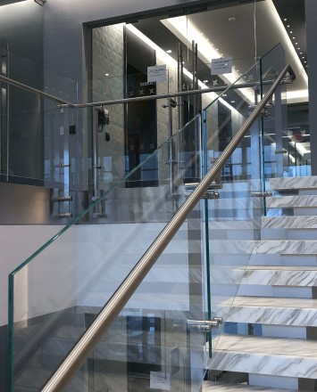 Atrium stair at Market Axess offices, Kubit glass railing system.
