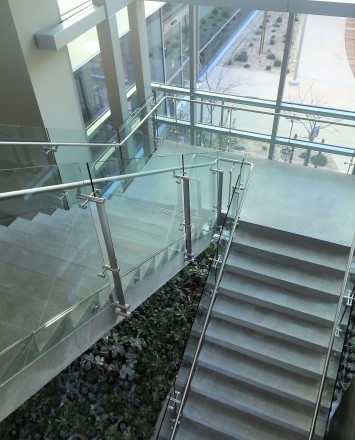 Konic guardrail installation with glass infill at Kaiser Permanente, CA.