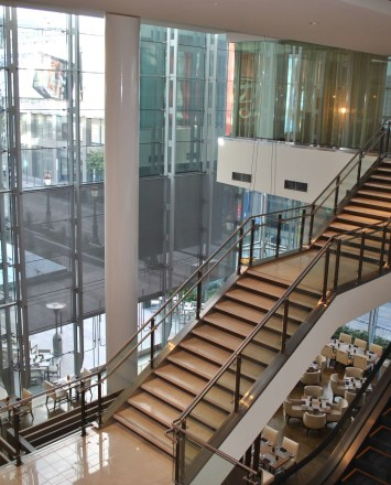 Ferric guardrail with glass infill installation at LA Live Convention Center, CA.