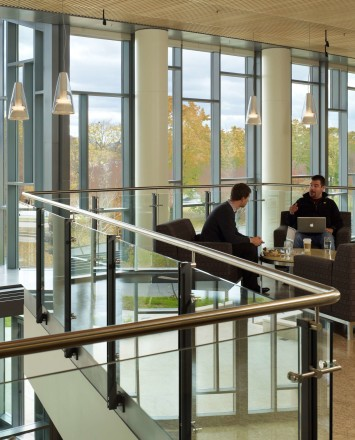 Ferric guardrail with glass infill installation at MIT Sloan School of Management, MA.