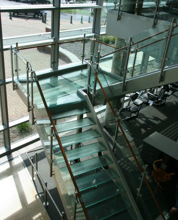 Circum round guardrail with glass infill and wood top rail at McDaniels College, MD