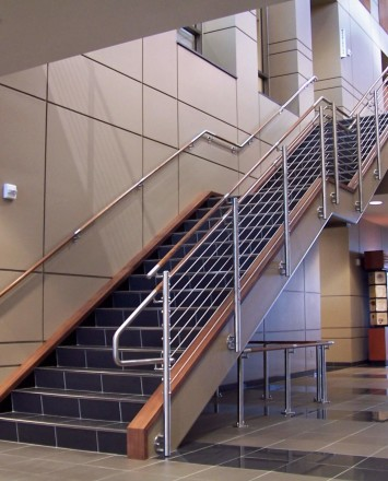 Circum round guardrail with infill rails and wood top rail at Midland National