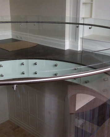 Second floor downward view in Private Residence, Washington DC, Optik guardrail with curved clear glass