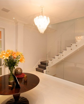 Entryway view of dual starwells in a Private Residence, Washington DC, Optik guardrail with clear glass