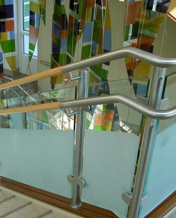 Circum guardrail installation with partially etched glass infill at Mercy Medical Center, OH.