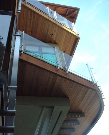 Ground level upward view of Kubit handrail system with glass infill at a Private California Residence