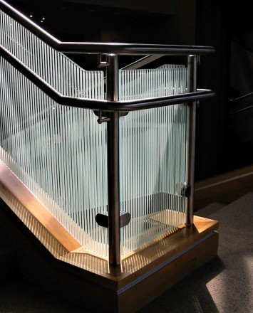 Circum guardrail with vertically etched glass infill installation at CTI Lobby