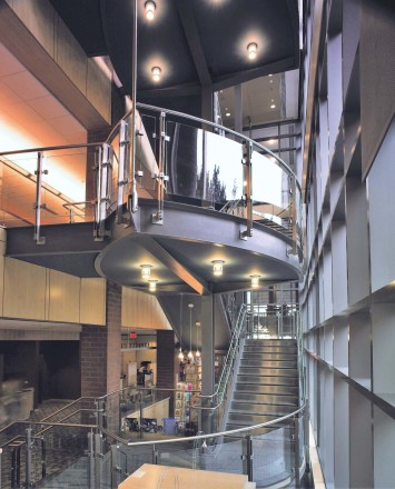 Inox curved handrail with glass infill installation at Princeton Public library, NJ.