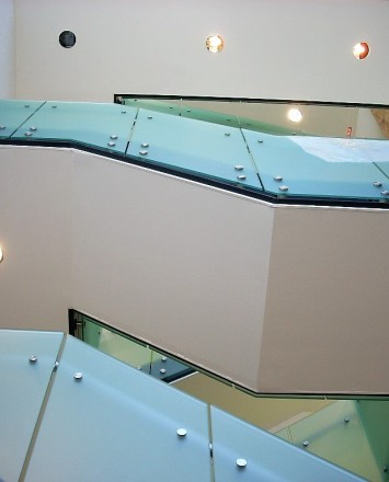 Upward stairwell view of Office building, CA, Optik guardrail with opaque etched glass