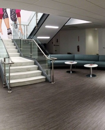 Stair at Full Beauty Brands offices, NY, Kubit glass railing system.