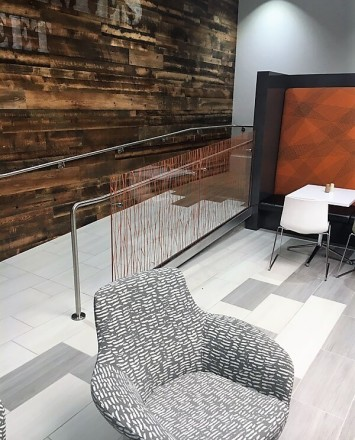Optik Shoe guardrail with cast patterned laminated glass infill installation at the Morgan Stanley, MD.