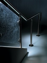 Dim lit view of CIRCUM guardrail with LED railing and specialty resin infill panel in a Pennsylvania Office.