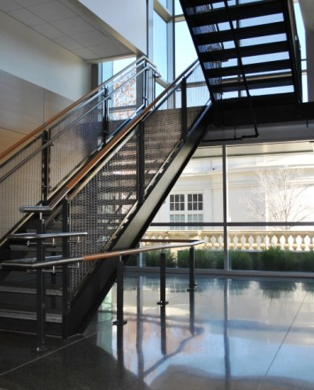 Open entryway at De Anza College, CA, Ferric guardrail with stainless steel posts and woven mesh infill panels