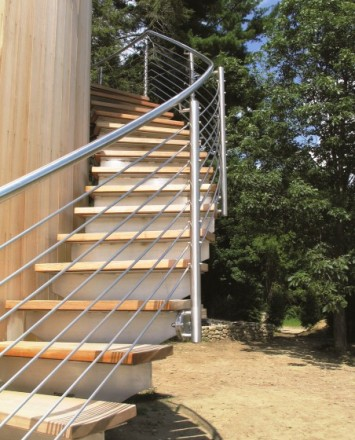 Upward view of curved Pool Cabana stairwell, Private Residence, CT, CIRCUM guardrail with stainless steel curved infill rails