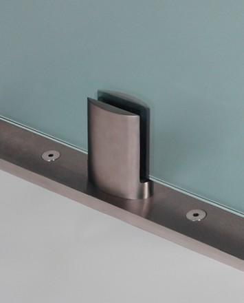 Closeup Studio shot of metal ellipsis Optik POD mounting hardware with glass infill