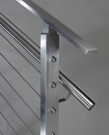 Closeup of stainless steel metal infill railing connections